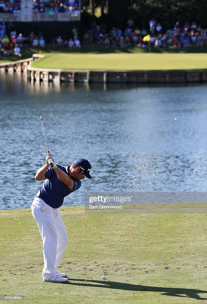 Louis Oosthuizen of South Africa plays his shot from the 17th tee during round one of THE PLAYERS Championship at the TPC Sawgrass Stadium course on May 7, 2015 in Ponte Vedra Beach, Florida.