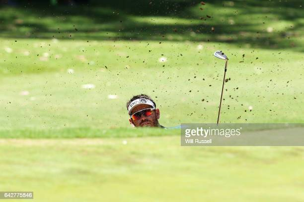 Louis Oosthuizen of South Africa plays out the bunker during round four of the ISPS HANDA World Super 6 Perth at Lake Karrinyup Country Club on...