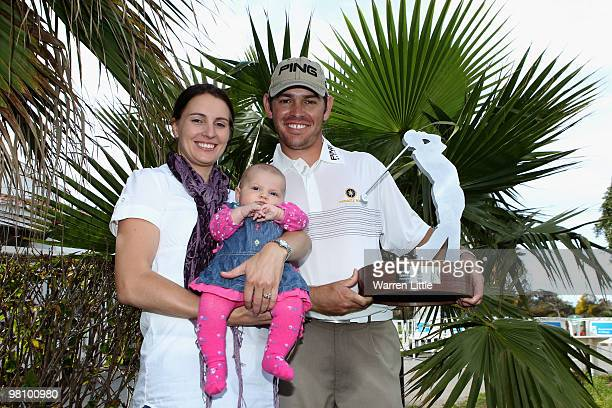 Louis Oosthuizen of South Africa poses with his wife NelMare and new born daughter Jana after winning the Open de Andalucia 2010 on a score of 17...