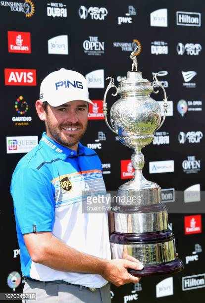 Louis Oosthuizen of South Africa poses with the trophy after victory in the final round on day four of the South African Open at Randpark Golf Club...