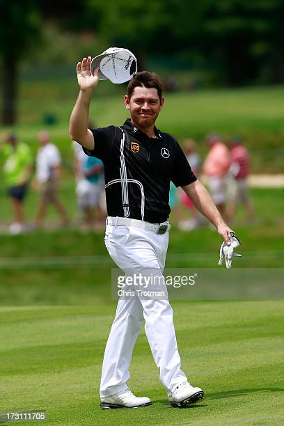 Louis Oosthuizen of South Africa reacts after after eagle on the second hole during the final round of the Greenbrier Classic at the Old White TPC on...