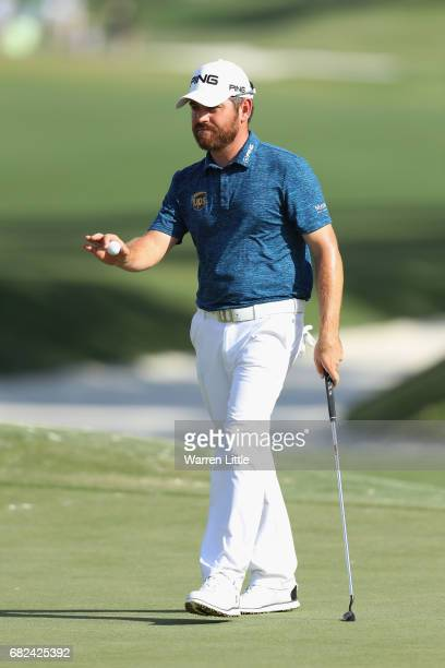 Louis Oosthuizen of South Africa reacts after finishing on the ninth green during the second round of THE PLAYERS Championship at the Stadium course...