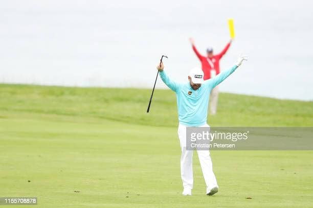 Louis Oosthuizen of South Africa reacts after holing out from the fairway on the 11th hole during the first round of the 2019 US Open at Pebble Beach...