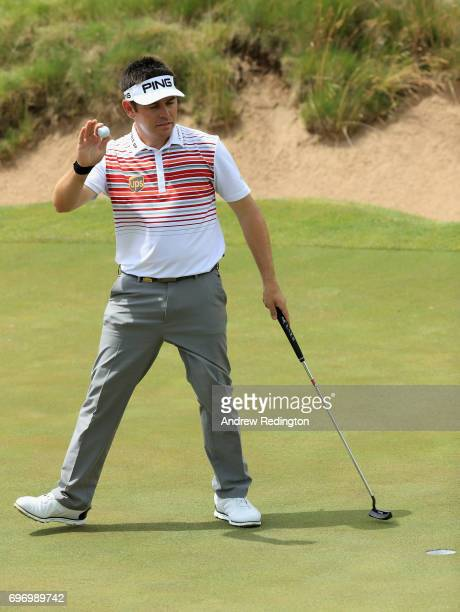 Louis Oosthuizen of South Africa reacts after making par on the 16th green during the third round of the 2017 US Open at Erin Hills on June 17 2017...