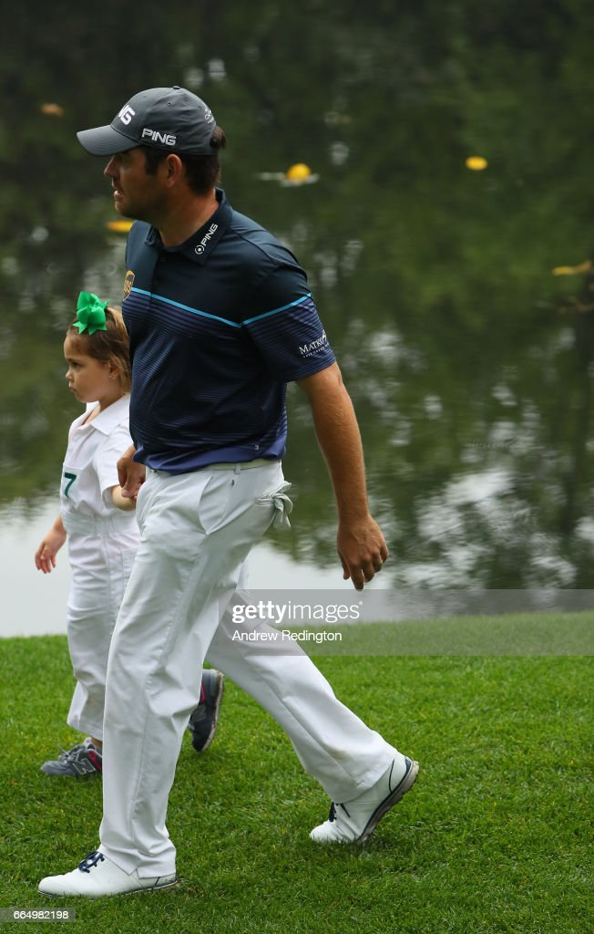 Louis Oosthuizen of South Africa walks with one of his three daughters during the Par 3 Contest prior to the start of the 2017 Masters Tournament at Augusta National Golf Club on April 5, 2017 in Augusta, Georgia. The Par 3 Contest was later cancelled due to inclement weather.