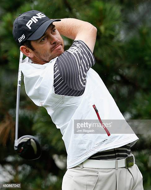 Louis Oosthuizen of South Africa watches his tee shot on the sixth hole during the first round of the Travelers Championship golf tournament at the...