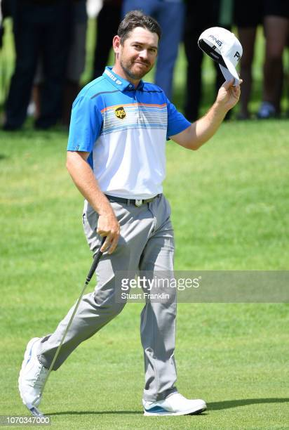Louis Oosthuizen of South Africa waves his cap to the fans on the 18th hole during the final round of the South African Open at Randpark Golf Club on...