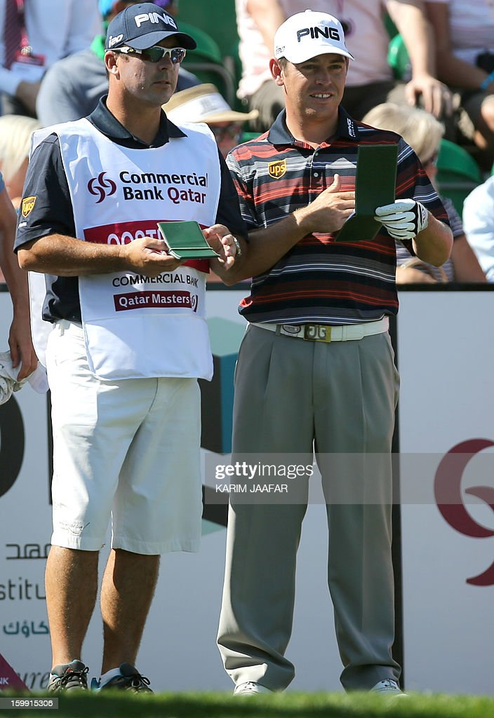 Louis Oosthuizen of South Africa with his caddie Wynand Stander stand together during the first round of the Qatar Masters golf tournament in Doha on January 23, 2013.