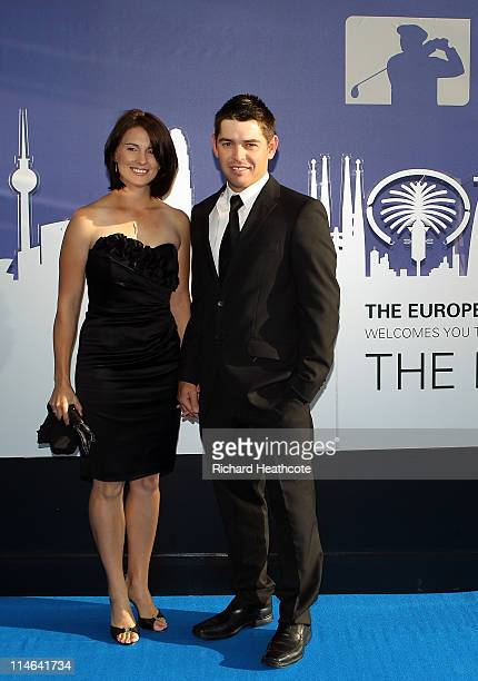 Louis Oothuizen of South Africa and wife NelMare arrive for the European Tour Players Awards Dinner at the Heathrow Sofitel Hotel on May 24 2011 in...