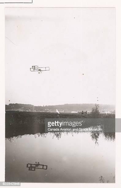 Louis Paulhan flies a biplane designed by Voisin near the Orge River during the 1909 Grande Quinzaine de Paris