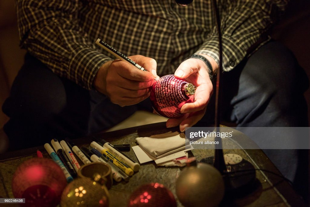 louis pfeiffer painting a christmas story on a red christmas bauble made out of glass in - When Was Christmas Story Made