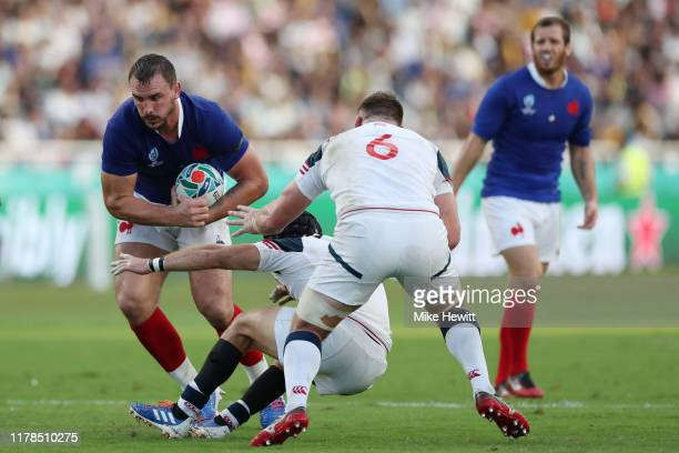 Louis Picamoles of France fends off Shaun Davies of the United States during the Rugby World Cup 2019 Group C game between France and USA at Fukuoka...