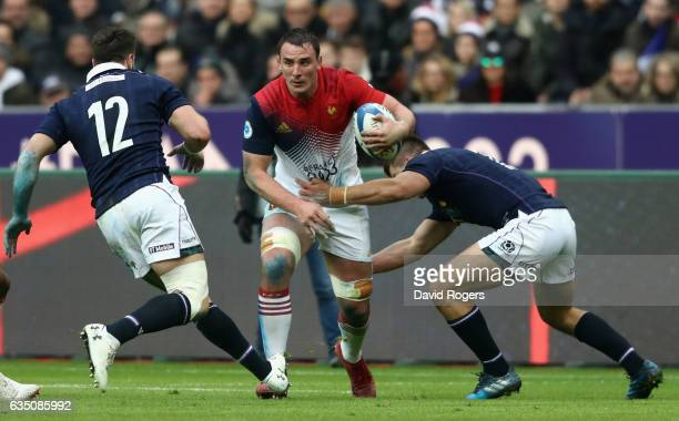 Louis Picamoles of France is tackled by Huw Jones and Alex Dunbar during the RBS Six Nations match between France and Scotland at Stade de France on...
