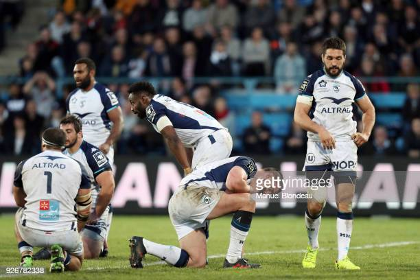 Louis Picamoles of Montpellier and his teammates look dejected during the French Top 14 match between SA Agen and Montpellier on March 3 2018 in Agen...