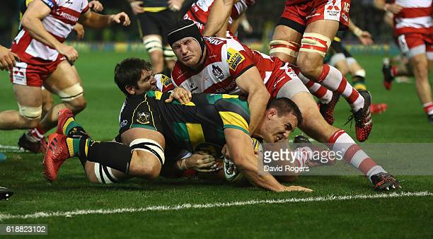 Louis Picamoles of Northampton dives over for the first try during the Aviva Premiership match between Northampton Saints and Gloucester Rugby at...