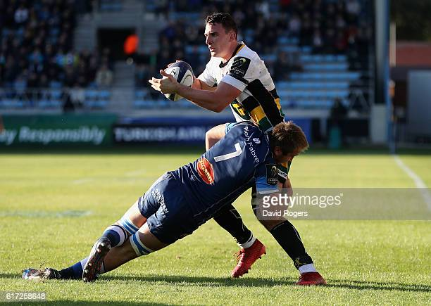 Louis Picamoles of Northampton is tackled by Anthony Jelonch during the European Rugby Champions Cup match between Castres and Northampton Saints at...