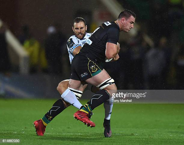 Louis Picamoles of Northampton Saints is tackled by Nic White of Montpellier during the European Rugby Champions Cup match between Northampton Saints...