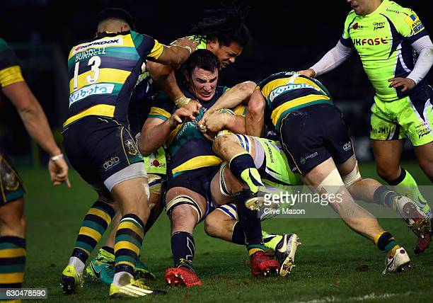 Louis Picamoles of Northampton Saints is tackled during the Aviva Premiership match between Northampton Saints and Sale Sharks at Franklin's Gardens...