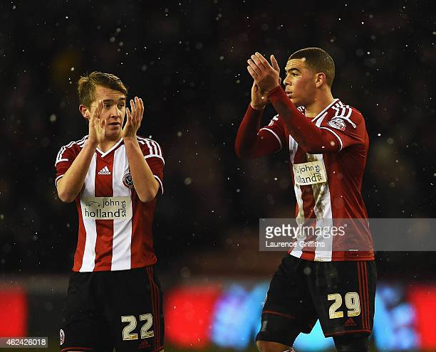 Louis Reed and Che Adams of Sheffield United applaud the fans after the Capital One Cup SemiFinal Second Leg match between Sheffield United and...