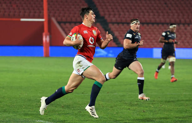 JOHANNESBURG, SOUTH AFRICA - JULY 07: Louis Rees-Zammit of The British and Irish Lions breaks away to score a try during the Cell C Sharks v British & Irish Lions tour match at Emirates Airline Park on July 07, 2021 in Johannesburg, South Africa. (Photo by David Rogers/Getty Images)