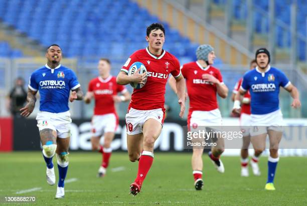 Louis Rees-Zammit of Wales breaks away to score their side's seventh try during the Guinness Six Nations match between Italy and Wales at Stadio...