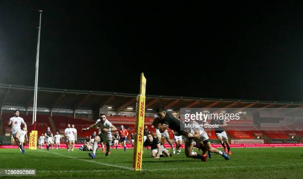 Louis Rees-Zammit of Wales dives over to score their sides first try during the Autumn Nations Cup 2020 match between Wales and Georgia at Parc y...