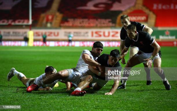 Louis Rees-Zammit of Wales scores his sides first try as Otar Giorgadze and Vasil Lobzhanidze of Georgia attempt to tackle during the Autumn Nations...
