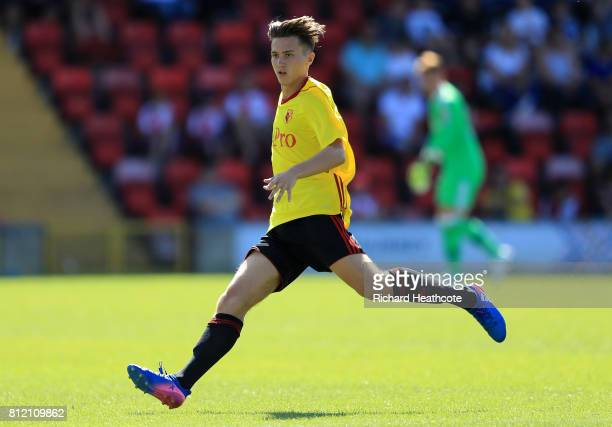 Louis Rogers of Watford in action during the preseason friendly match between Woking and Watford U23 at the Laithwaite Community Stadium on July 08...