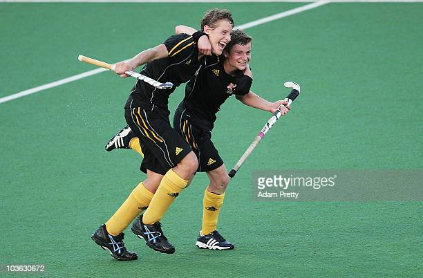 Louis Rombouts of Belgium is congratulated after scoring a goal during the Boys Bronze Medal Hockey match between Belgium and Ghana on day 11 of the...