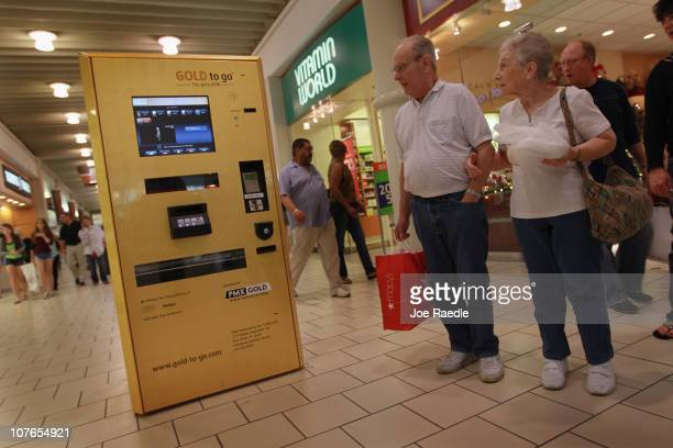 Louis Ronner and Terry Ronner check out the GOLD to go vending machine setup at Boca Raton's Town Center Mall on December 17 2010 in Boca Raton...