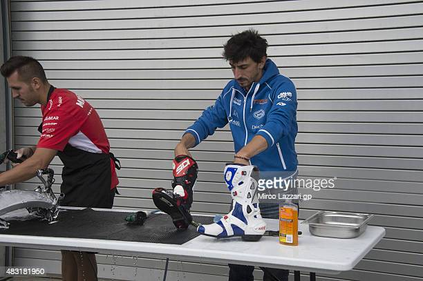 Louis Rossi of France and Tasca Racing Scuderia Moto2 cleans the boots in paddock during the MotoGp Red Bull US Indianapolis Grand Prix Previews at...