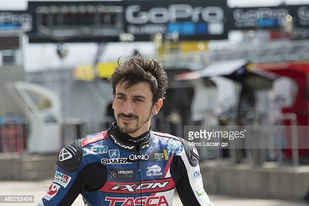 Louis Rossi of France and Tasca Racing Scuderia Moto2 walks in pit during the MotoGp of Germany Free Practice at Sachsenring Circuit on July 10 2015...