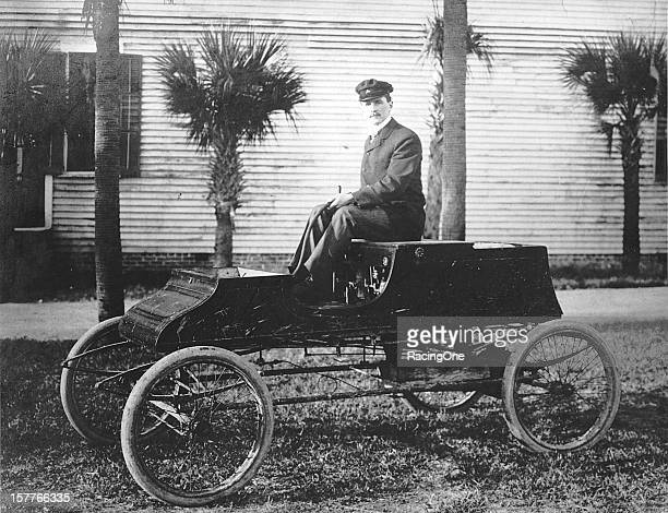 Louis S. Ross holds the steering tiller as he sits aboard an early version of a steam-powered automobile. Ross later formed his own company and...