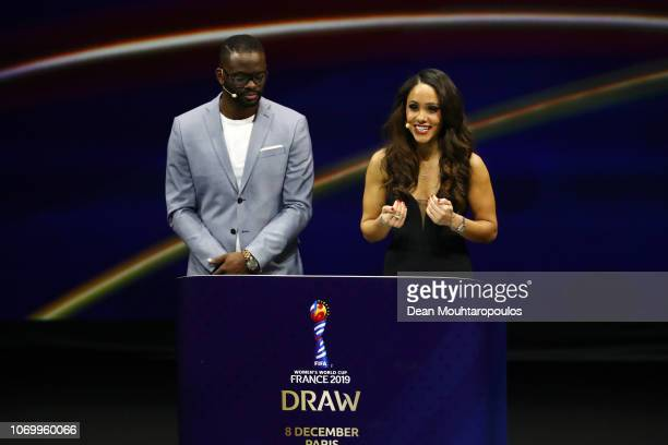 Louis Saha and Alex Scott on stage during the FIFA Women's World Cup France 2019 Draw at La Seine Musicale on December 8 2018 in Paris France