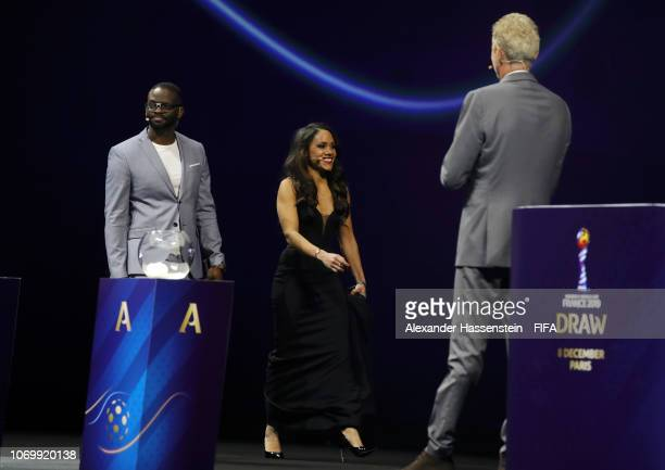Louis Saha and Alex Scott walk onto the stage during the FIFA Women's World Cup France 2019 Draw at La Seine Musicale on December 8 2018 in Paris...