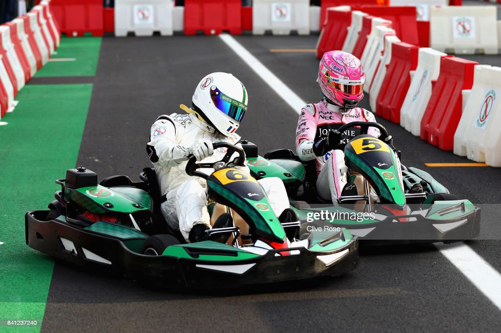 Louis Saha competes with Esteban Ocon of France and Force India in a karting event during previews for the Formula One Grand Prix of Italy at Autodromo di Monza on August 31, 2017 in Monza, Italy.