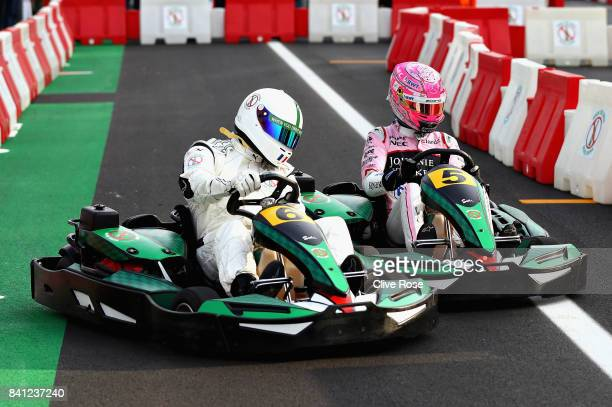 Louis Saha competes with Esteban Ocon of France and Force India in a karting event during previews for the Formula One Grand Prix of Italy at...