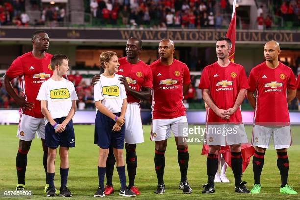 Louis Saha Dwight Yorke Quinton Fortune Keith Gillespie and Danny Webber of the Manchester United Legends line up for the national anthems during the...