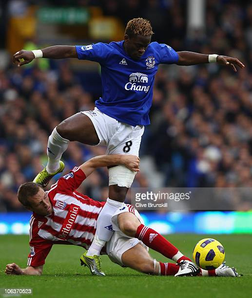 Louis Saha of Everton attempts to move past a challenge from Danny Collins of Stoke City during the Barclays Premier League match between Everton and...