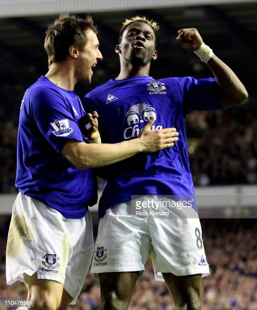 Louis Saha of Everton celebrates scoring his team's second goal with team mate Phil Jagielka during the Barclays Premier League match between Everton...