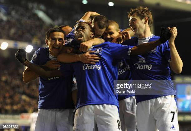 Louis Saha of Everton celebrates scoring his team's second goal with his team mates during the Barclays Premier League match between Everton and...