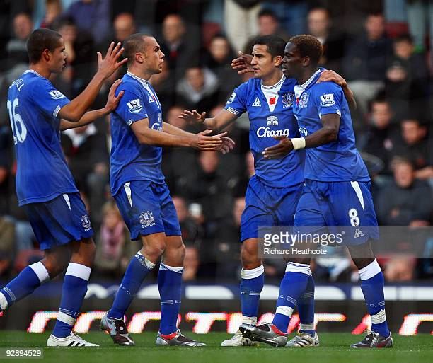 Louis Saha of Everton celebrates scoring the first goal of the game with Tim Cahill Johnny Heitinga and Jack Rodwell during the Barclays Premier...
