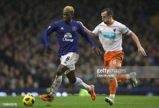 Louis Saha of Everton in action with Charlie Adam of Blackpool during the Barclays Premier League match between Everton and Blackpool at Goodison...