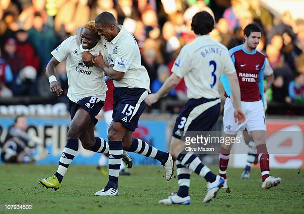 Louis Saha of Everton is congratulated for his 10 goal by teammate Sylvain Distin during the FA Cup sponsored by Eon 3rd round match between...