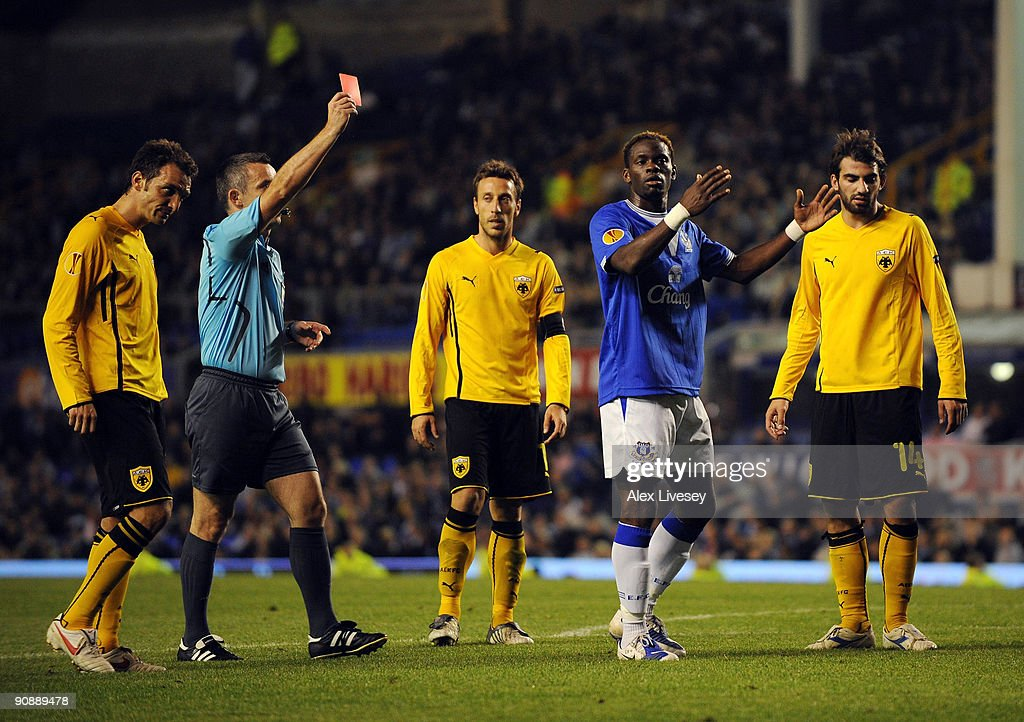 Louis Saha of Everton is sent off by referee Robert Malek during the UEFA Europa League Group I match between Everton and AEK Athens at Goodison Park on September 17, 2009 in Liverpool, England.