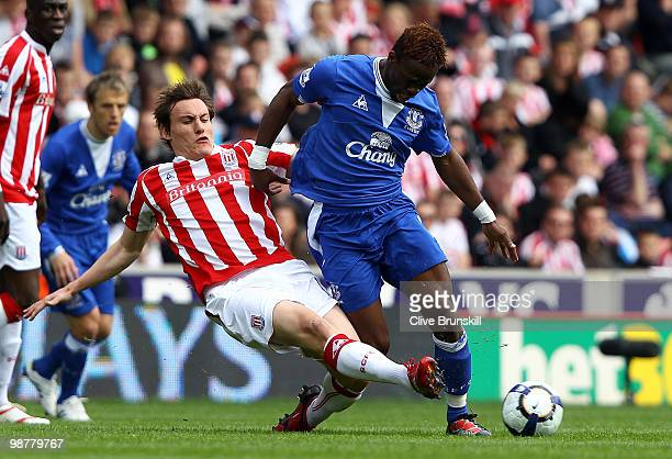 Louis Saha of Everton is tackled by Dean Whitehead of Stoke City during the Barclays Premier League match between Stoke City and Everton at Britannia...