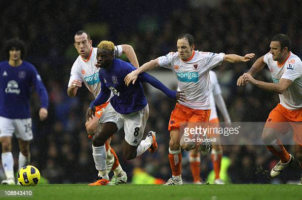 Louis Saha of Everton moves away from Charlie Adam and David Vaughan of Blackpool during the Barclays Premier League match between Everton and...