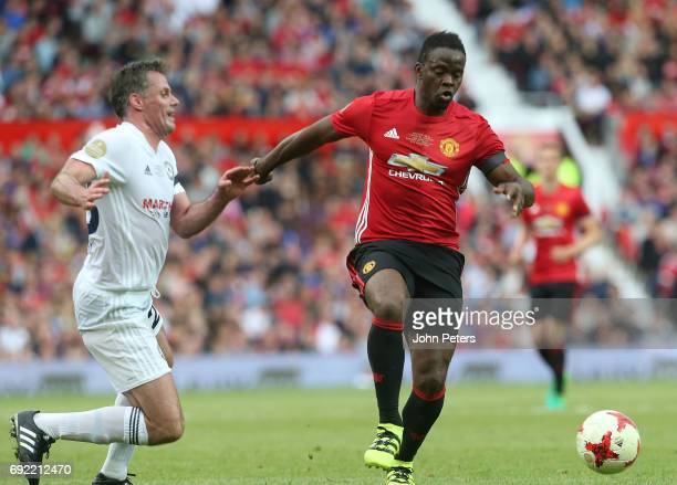 Louis Saha of Manchester United '08 XI in action with Jamie Carragher of Michael Carrick AllStars during the Michael Carrick Testimonial match...