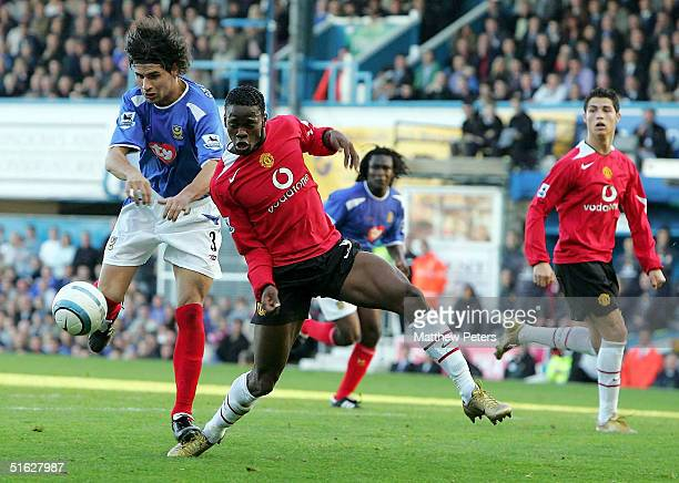 Louis Saha of Manchester United clashes with Dejan Stefanovic of Portsmouth during the Barclays Premiership match between Portsmouth and Manchester...