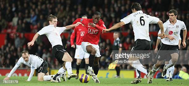 Louis Saha of Manchester United clashes with Steve Davis and Dejan Stefanovic of Fulham during the Barclays FA Premier League match between...
